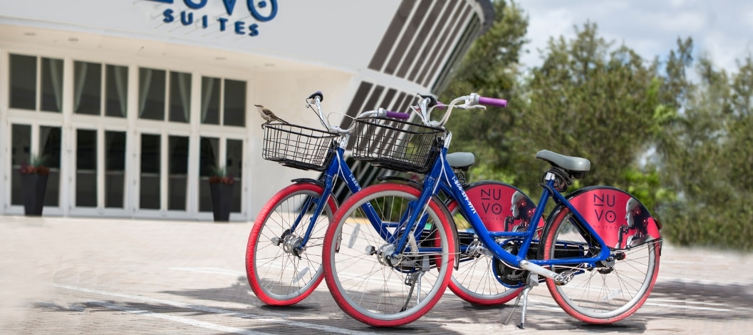 Two Nuvo bicycles parked in front of the Nuvo Suites entrance