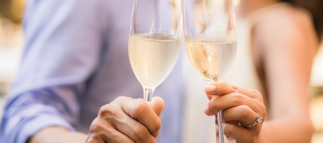 Man and woman holding champagne glasses