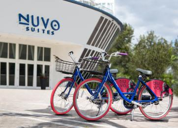 2 Bikes in front of Nuvo Suites hotel